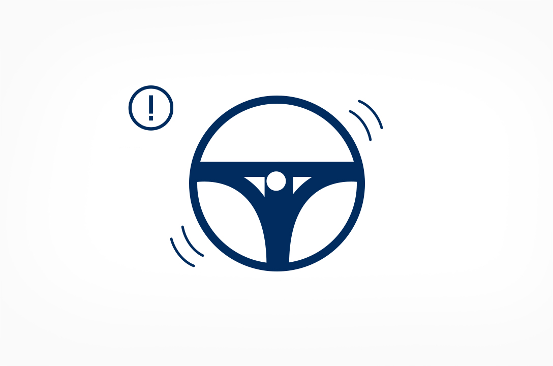 A steering wheel warns driver as it detected distracted driving.