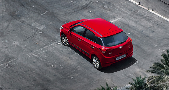 Sky view of red Elite i20 parked at the parking lot