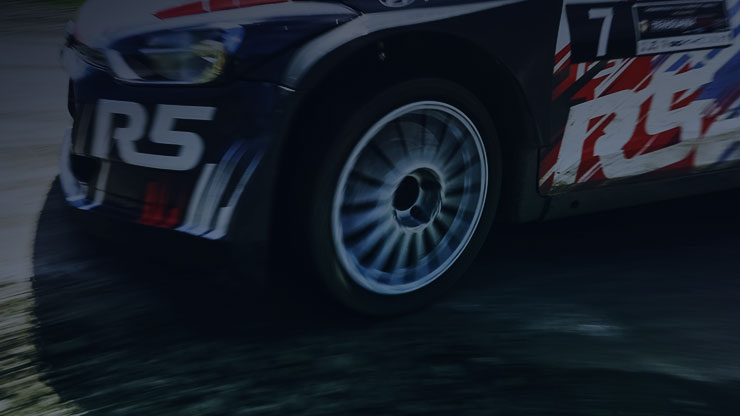 left side view of i20 R5 speeding front wheel