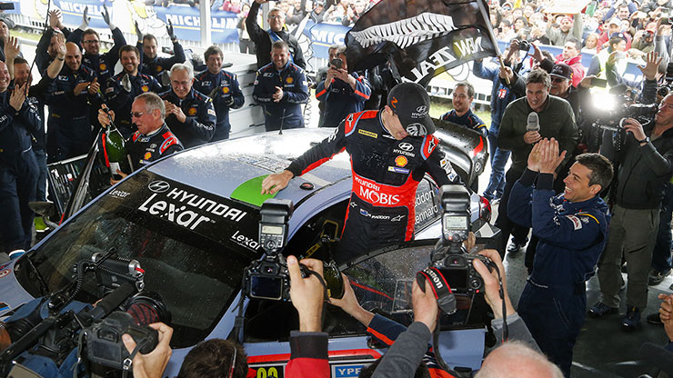 hayden paddon stands on the car to celebrate his first victory in the rally argentina