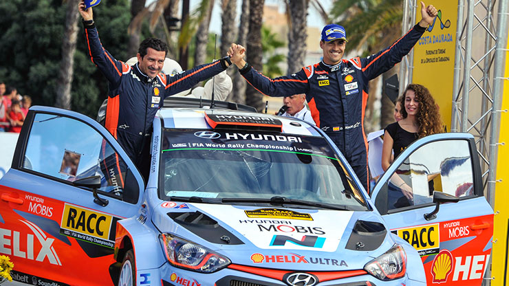 spaniard dani sordo stands on the opened door car and leads the way with podium at home