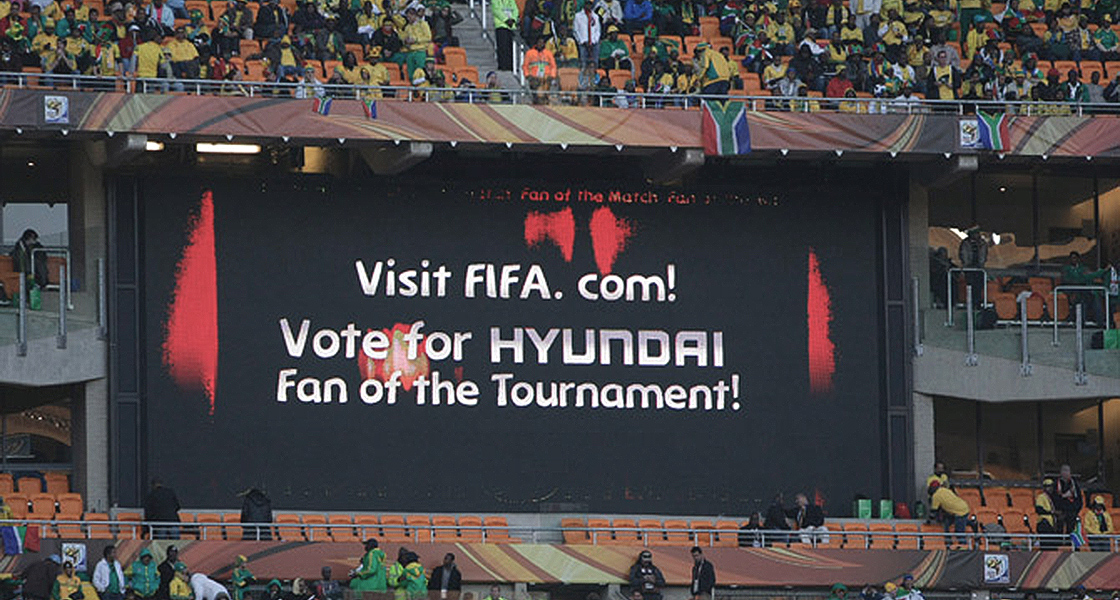 'The board with text 'Fan of the Tournament' is installed in the stadium