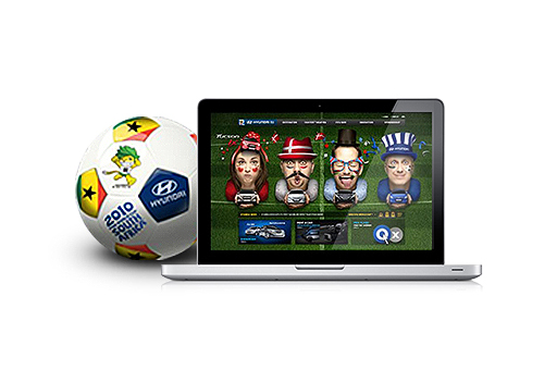FIFA World Cup micro-site screen displayed on the laptop and soccer ball laid beside